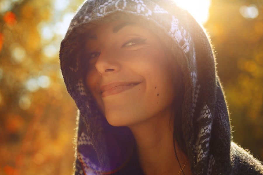 face of beautiful woman in the fall sun to show fall skin care tips