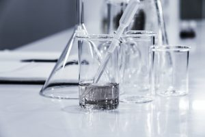glass beakers in a lab used to study abcs of skin care based on science